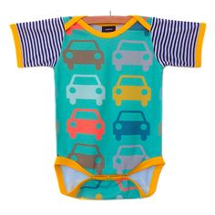 This one piece is done in a turquoise car pattern with yellow trim, great for a boy or a girl. It can be made in short or long sleeves in the following sizes… Newborn – 3 months (up to 13 lbs) 3 – 6 months (up to 18 lbs) 6 – 12 months (up to 22 lbs) 12 – 18 months (up to 26 lbs) 18 – 24 months (up to 30 lbs) Also available in toddler t-shirts starting at size 2T and up for $28.00. Convo me if you are interested and I will set up a reserved listing with the correct pricing for you. Fabric…