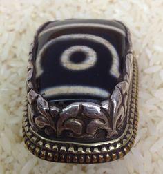 Tibetan Silver Dzi Bead Ring by WorldofBacara on Etsy https://www.etsy.com/listing/216974145/tibetan-silver-dzi-bead-ring