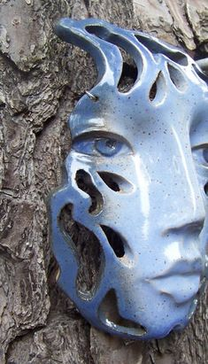 Blue Raindrop Face/ Wall Art Hanging Ceramic Mask With Cut Out Design. $42.00, via Etsy.