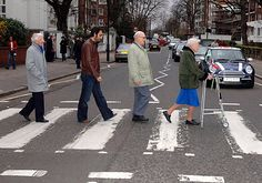 The Zimmers: World's oldest rockers, with combined age of 3000, set to storm charts.  The Zimmers strike the familiar Beatles pose as they cross Abbey Road.