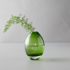 This gorgeous vase is crafted using colorful glass for a bright, cheerful appeal.- Glass- Wash with warm soap and water- diameter Apartment Entryway, Outdoor Garden Furniture, Vases Decor, Bud Vases, Colored Glass, Flower Decorations, Outdoor Gardens, Planting Flowers, Floral Arrangements