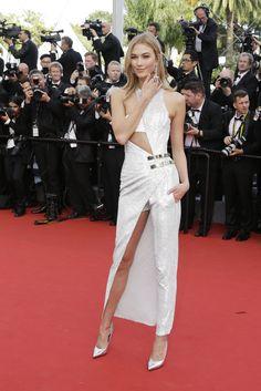 "Karlie Kloss in a Versace dress at the Cannes Film Festival premiere of ""La Tête Haute."" (Photo: Thibault Camus/Associated Press)"