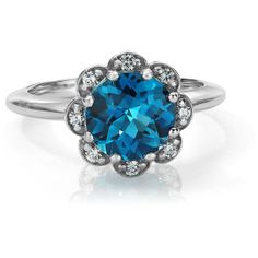 Blue Nile London Blue Topaz and Diamond Flower Ring in 14k White Gold ($900) ❤ liked on Polyvore