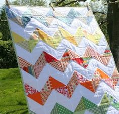 The more I see this quilt, the more I fall in love with it.  I'm totally intimidated by the triangles though.