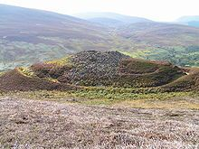 The remains of Kilphedir broch, Sutherland, are surrounded by massive earthworks. Brochs seem to be found only in Scotland