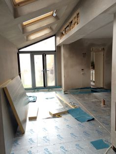 Floor insulation going in and vapour barrier