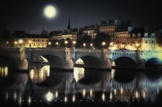 Moonrise Over Pont Neuf Paris France.  When visiting The City of Lights, my days usually begin and end here, my favorite place in Paris. It's a swirl of activity with dozens of cultural greats surrounding it; the Louvre,  the Eiffel Tower and Notre Dame Cathedral, the Seine Riverfront walkways and the D'Orsay Museum to name a few. The list is endless. A wonderful place you must visit. - John Brody Photography