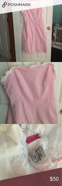Pink seersucker Lily Pulitzer dress Size 12. Spaghetti straps, built in bra. Excellent condition.  Have two seersucker dresses listed. Want to sell one but am somewhat flexible on price and which one. Lilly Pulitzer Dresses