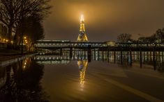 Download wallpapers Eiffel Tower, fog, evening, lights, city lights, Paris, France