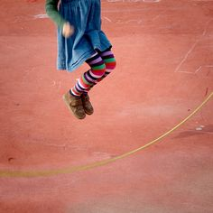 Jumping rope -- Cinderella dressed in yellow went upstairs to kiss her fellow! Made a mistake, kissed a snake! How many doctors did it take? Foto Fun, Skipping Rope, Cinderella Dresses, Jumping For Joy, Childhood Days, Little Doll, Color Photography, Outdoor Photography, The Good Old Days
