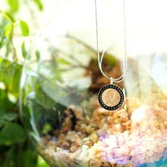 Queen Elizabeth II 5 pounds gold plated coin with hemetite beads setting on a silver necklace
