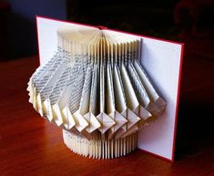 A simple yet beautiful ornament made from an old book! . Make a piece of book art in under 40 minutes by papercrafting and paper folding with book. Creation posted by Heidi. Difficulty: Easy. Cost: Absolutley free.