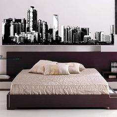 Wall decal of a cityscape behind a bed - cool idea!