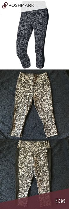 """Nike Jeweled Capris These are the color as shown in the stock photo. For whatever reason my camera won't pick up the dark grey shade. Approximate measurements when flat: inseam 19 1/2"""" Nike Pants Capris"""