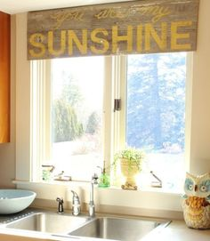 Make a stenciled barn-wood valance! Turn a sign made from old barn wood and stenciled with happy song lyrics into a nontraditional window treatment.