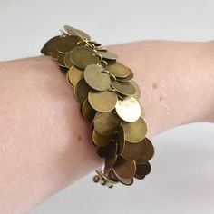 Make a coin beaded braid for a perfect belly dancer Kumihimo bracelet that tinkles and delights! Coin Jewelry, Metal Jewelry, Jewelry Crafts, Beaded Jewelry, Jewlery, Kumihimo Bracelet, Bracelet Making, Jewelry Making, Belly Dance Jewelry