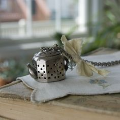 vintage tea strainer shaped like a teapot.  Cute!