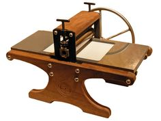 This 12-pound miniaturized etching press is from the Halfwood Press line made in Seattle and England. Designed by Seattle artists Bill Ritchie, it