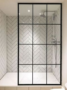 I'm in love with the herringbone tile and the amazing crittall shower screen from Creative Glass Studio in London Modern Bathroom Tile, Mosaic Bathroom, Bathroom Interior Design, Mosaic Tiles, Bathroom Glass Wall, Bathroom Lighting, Bathroom Black, Bathroom Subway Tiles, Modern Bathrooms