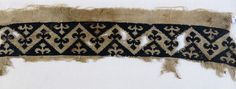 Textile fragment with band of chevrons and trefoil finials. Linen, embroidered with silk. 14th c. Found in Egypt. Jameel Centre for Islamic and Asian Art, Ashmolean.