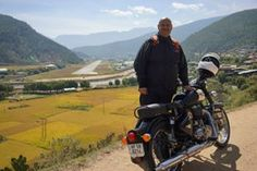 Coming out of Thempu town on our Bhutan ride.