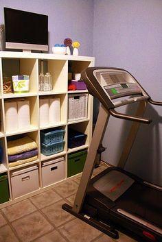 Basement workout room. I like the shelf for storage/display