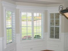 3.5 in Plantation Shutters - Single Panels - No Center Divider Rail with Pediment over top - in Bay Window.jpg