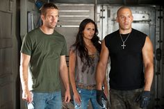 Paul Walker as Brian O'Conner, Jordana Brewster as Mia Toretto and Vin Diesel as Dominic Toretto in FAST FIVE (2011).