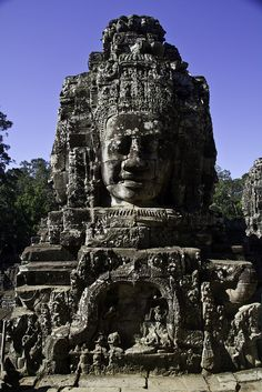 The Bayon (Khmer: ប្រាសាទបាយ័ន, Prasat Bayon) is a well-known and richly decorated Khmer temple at Angkor in Cambodia. Built in the late 12th century or early 13th century as the official state temple of the Mahayana Buddhist King Jayavarman VII, the Bayon stands at the centre of Jayavarman's capital, Angkor Thom. Following Jayavarman's death, it was modified and augmented by later Hindu and Theravada Buddhist kings in accordance with their own religious preferences