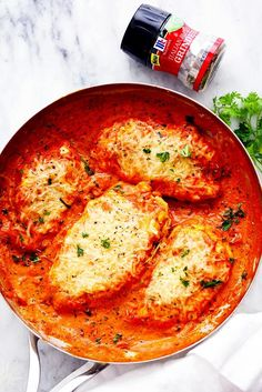 Creamy Tomato Italian Parmesan Chicken is a creamy red tomato parmesan sauce with delicious italian spices. The chicken gets smothered ...