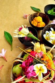 10987771-balinese-hindu-offerings-with-flowers.jpg 801×1,200 pixels