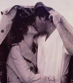 Kissing in the rain. Also symbolic in a way because you are kind of saying that even in the not-of-best of times you are still going to make time for what is important, which includes you among other things.