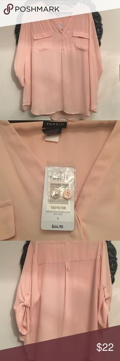 Torrid blouse Light pink torrid sheer blouse with 3/4 sleeve option or long sleeve. Pretty flowy fabric 100% polyester. New never worn. Size 3 from torrid runs true to size/ little big torrid Tops Blouses