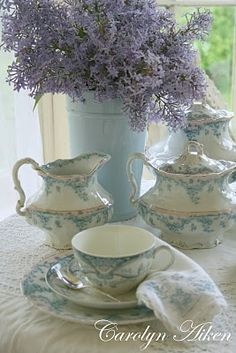 Soft blue and white china, lacy flowers and beautiful linens and lace.