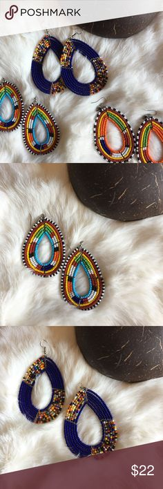 Stunning Handbeaded Earrings From Kenya Wow your outfit with these stunning glass beaded, handmade earrings from Kenya. Three separate pairs listed. Purchase all three or your favorite one. In baby blue, cobalt blue or orange. Bohemian Jewelry Earrings