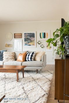 Moroccan Shag Rug with gallery wall. Warm neutrals.
