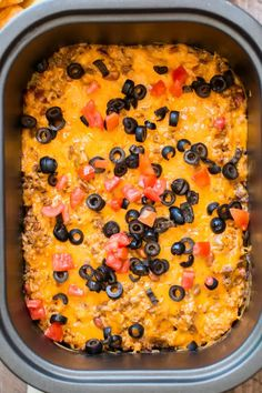 enchilada dip in a slow cooker with cheese, tomato and olives. Slow Cooker Appetizers, Slow Cooker Recipes, Appetizer Recipes, Crockpot Recipes, Cooking Recipes, Dip Recipes, Beef Enchilada Dip, Beef Enchiladas, Enchilada Casserole