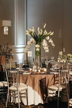 Stand out with this large arrangement of white lilies and orchids. Tall Centerpiece, Centerpiece Ideas, Centerpieces, Wedding Shit, Wedding Wishes, Grand Hyatt, White Lilies, Wedding Table Settings, Outdoor Weddings