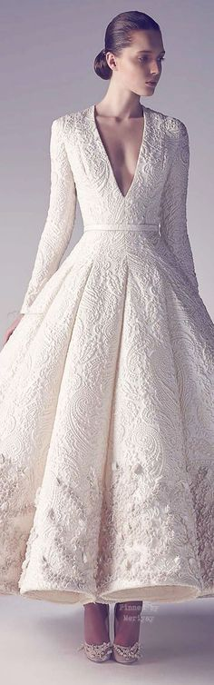Look at this deep v neck wedding dress with long sleeves. This haute couture gown is unique and subtle with its classy lines. A designer wedding dress like this one could be extremely costly when purchased direct from the fashion designers runways. Style Haute Couture, Couture Fashion, Couture 2015, Dress Fashion, Couture Ideas, Haute Couture Gowns, Party Fashion, Evening Dresses, Prom Dresses