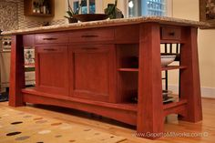 Richmond Virginia creative custom kitchen design inspired by Frank Lloyd Wright organic architecture priare style. Kitchen Island granite countertops wooden archetectural details with open shelving for an organic zen feel.
