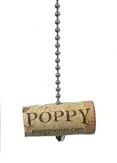 "WINE bottle CORK Ceiling FAN PULL light chain  Add the perfect touch to any room in the house with this REAL wine bottle cork ceiling fan pull. Made of cork. Easy to attach to your existing chain. Measures approx. 2 L with a 5""L chain. """