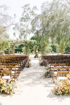This outdoor California wedding venue was rustic, trendy and unique. These wooden ceremony chairs created a beautiful aisle for the bride. Click to see more inspiration from this beautiful laid back cool-girl wedding. #Wedding #Venue #WeddingVenue #Rustic #OutdoorWedding #WeddingInspiration #WeddingIdeas #WeddingCeremony #WeddingDecor
