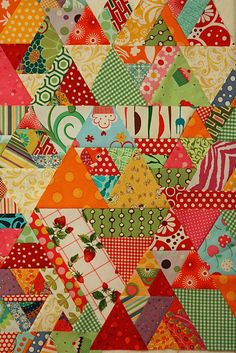 Triangles--Can't decide if I like this quilt or if it makes me dizzy or maybe crazy.  :D