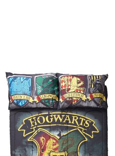 "<div>The perfect pillowcases to take to wizarding school! Show school pride for Hogwarts with these pillowcases from <i>Harry Potter.</i> They feature house crests for Gryffindor, Ravenclaw, Hufflepuff and Slytherin! </div><div><ul><li style=""LIST-STYLE-POSITION: outside !important; LIST-STYLE-TYPE: disc !important"">20"" x 30""</li><li style=""LIST-STYLE-POSITION: outside !important; LIS..."