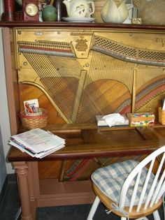 convert an old piano into a desk it looks really neat. Now I just need an old piano!!
