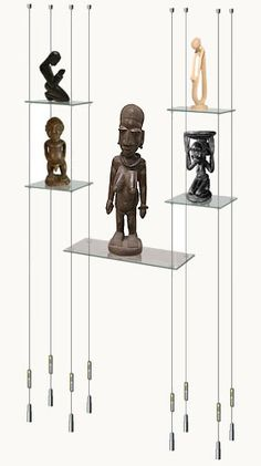 Suspended glass display shelves (between living/dining areas) no african carvings, though