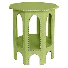 Faux leather octagonal side table in light green with nailhead trim.   Product: Side tableConstruction Material: Polyu...