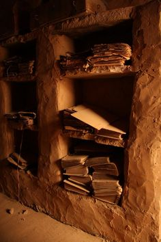 The other handful of libraries still surviving in Chinguetti however are very much time capsules of the medieval era in which they were first built, storing the ancient books in simple cardboard binders on open shelving, vulnerable to the elements.