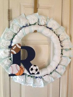 Sports themed baby shower neat ideas on this site party custom made diaper wreath with wooden initial sports theme for baby boy on etsy 4500 negle Image collections