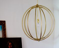 Emily Henderson is a genius! This light is made out of dollar store hula hoops.